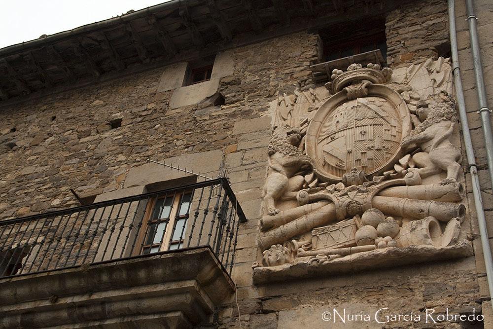 Escudo en la fachada de una casa